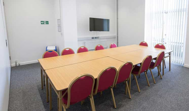 Meeting Room 1 at the Assembly Rooms in Chesterfield with a conference table set up with seating.