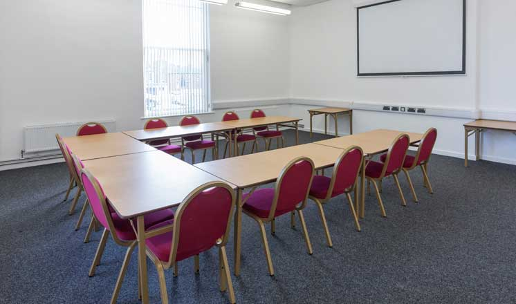 Meeting tables set out in a u-shape in Meeting Room 2 at the Assembly Rooms.