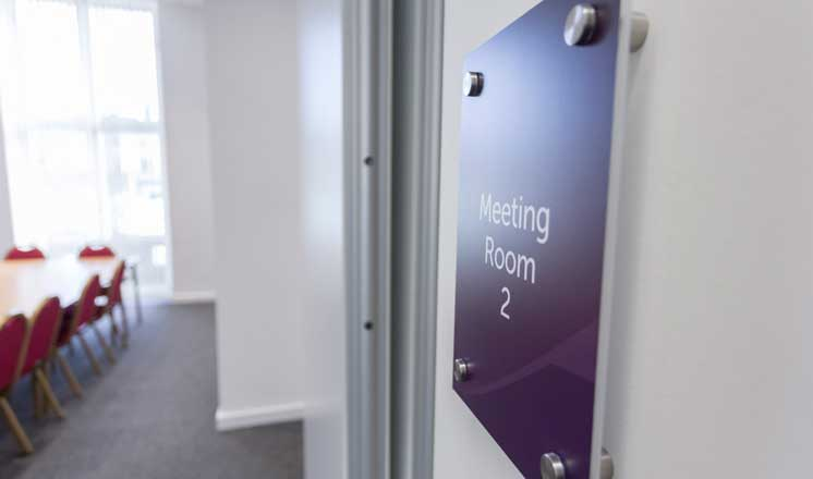 The entrance to Meeting Room 2 at the Assembly Rooms. A conference table is visible to the side.