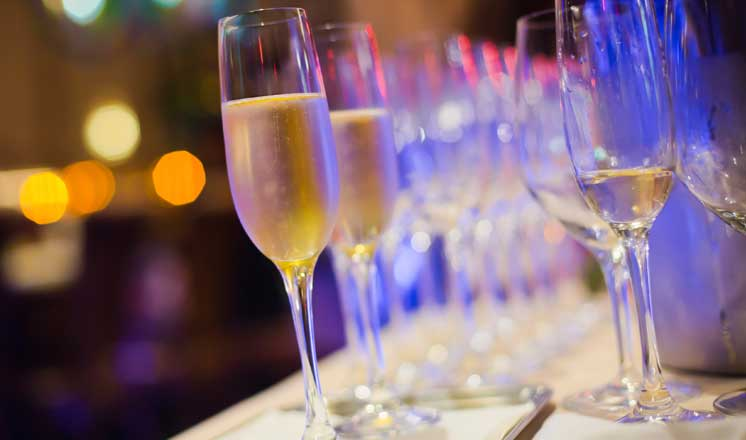 Rows of filled champagne glasses.