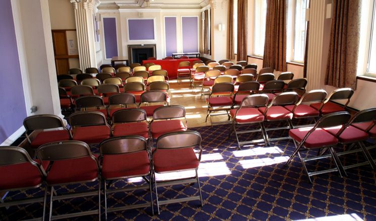 The function room at the Winding Wheel set up with rows of seating for a meeting.