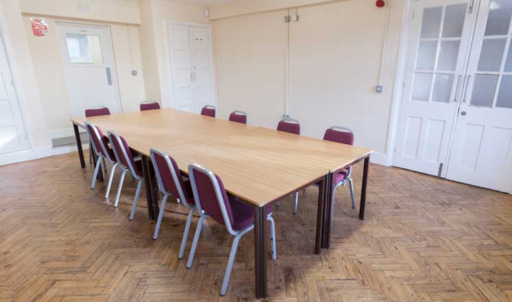 A meeting table set up in the Meeting Room at Hasland Village Hall.