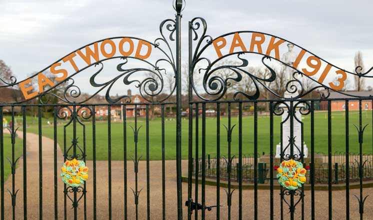 Black iron gates at Eastwood Park where Hasland Village Hall is located.