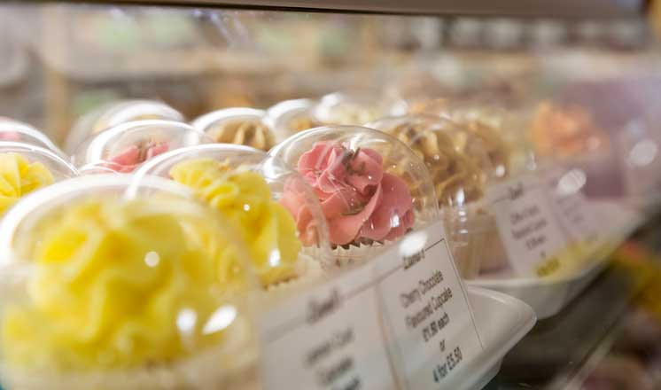 A variety of cupcakes at a Market Hall bakery.