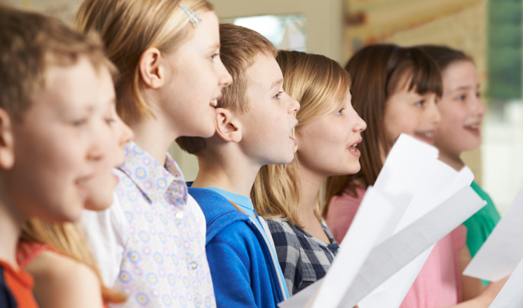 A group of children singing in a choir at Chesterfield Theatres